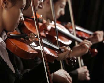 Symphony music, violinists at concert